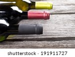wine bottles on a wooden table | Shutterstock . vector #191911727