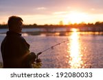 a fisherman with a fishing rod... | Shutterstock . vector #192080033