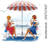 Two Beautiful Women Sitting At...