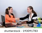 Small photo of Schoolmarm congratulated apprentice, shaking her hand with successful execution of tasks
