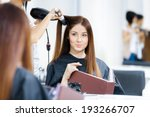 Постер, плакат: Reflection of hairdresser doing