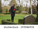 Young Woman Visiting A Loved...