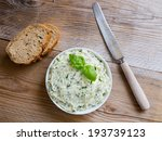 Herb Butter In A Bowl On Wood.