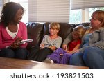 Small photo of Social Worker Talking To Mother And Children At Home