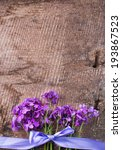 Small photo of Fresh hesperis flowers on aged wooden background. Selective focus, vertical.