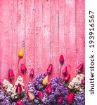 Stock photo various tulips and lilac on pink wooden background 193916567