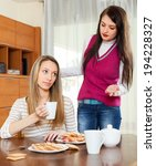 women having quarrel over tea... | Shutterstock . vector #194228327