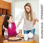 women having quarrel over tea... | Shutterstock . vector #194606687