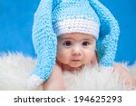 baby boy on blue laughing | Shutterstock . vector #194625293