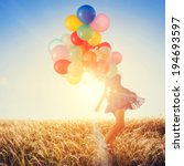 girl with balloons running on... | Shutterstock . vector #194693597