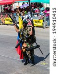 Small photo of Barranquilla, Colombia - March 1, 2014- A man dressed as a soldier joins the parade during the Battalia de Flores.
