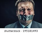man with mouth covered by... | Shutterstock . vector #195181493