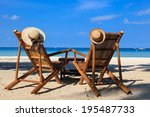 Hats On Beach Chairs Of...