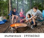 father camping with kids while... | Shutterstock . vector #195560363