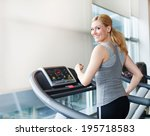 young woman exercising on... | Shutterstock . vector #195718583