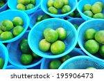 fresh green limes in a basket | Shutterstock . vector #195906473