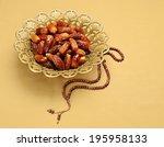 An Ornamental Bowl Of Dates An...