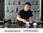 young caucasian barman wearing... | Shutterstock . vector #195961067