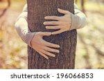 Tree Hugging. Close Up Of Hand...