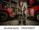 firefighter near truck with... | Shutterstock . vector #196143827