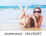 young woman in bikini lying on... | Shutterstock . vector #196150397