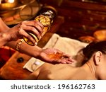 young woman having oil massage... | Shutterstock . vector #196162763