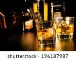 barman pouring whiskey in front ... | Shutterstock . vector #196187987