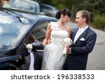 bride and groom near the car | Shutterstock . vector #196338533