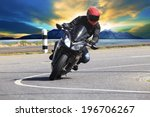 Young Man Riding Motorcycle In...