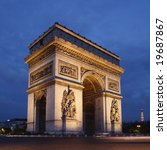 Paris, the beautiful Arc de Triomphe at night. - stock photo