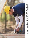 carpenter cutting rafters and... | Shutterstock . vector #196964147