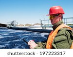 Small photo of An engineer controlling a quality of water ,aerated activated sludge tank at a waste water treatment plant