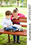 little boy and girl is reading... | Shutterstock . vector #197351507