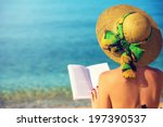 young girl reading a book at... | Shutterstock . vector #197390537