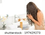 young woman with wet hairs in... | Shutterstock . vector #197429273