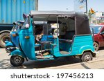 Постер, плакат: Blue tuk tuk vehicle parked
