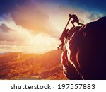 hikers climbing on rock ... | Shutterstock . vector #197557883