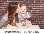 young mother playing with... | Shutterstock . vector #197648507