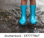 Child Wearing Blue Rain Boots...