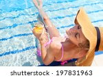 pretty blond woman in a hat... | Shutterstock . vector #197831963