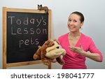 Small photo of Schoolmarm woman tells children about pets