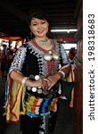 Small photo of KOTA KINABALU, MALAYSIA - MAY 30 : Dusun Tindal lady in colorful traditional costume poses for the public during Harvest Festival celebration May 30, 2014 in Kota Kinabalu, Sabah, Malaysia.