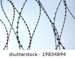 fence with barbed wire under... | Shutterstock . vector #19834894