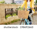 Woman Riding Bicycle With...