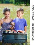 happy kids preparing meat and... | Shutterstock . vector #198887327
