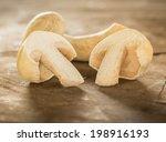 Fresh White Mushrooms On Woode...