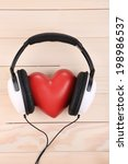 Headphones And Heart On Wooden...