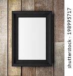 frame on wooden wall   Shutterstock . vector #198995717