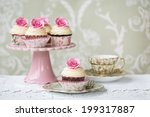 afternoon tea with rose cupcakes | Shutterstock . vector #199317887