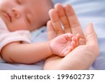 new born baby hand | Shutterstock . vector #199602737